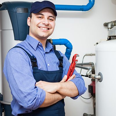 Smiling employee working on heater